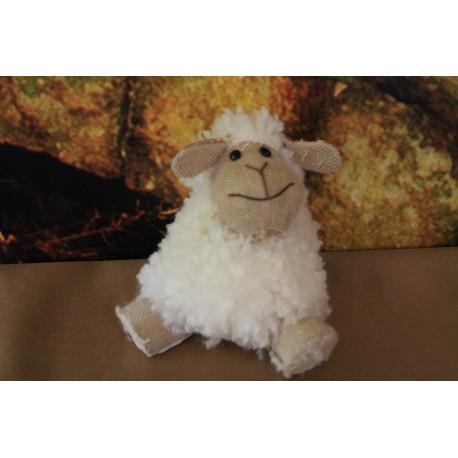 mouton assis.