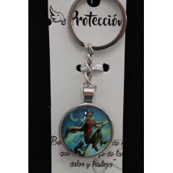 Porte clefs double face représentant une sorcière à cheval sur son balai. Porte-bonheur.