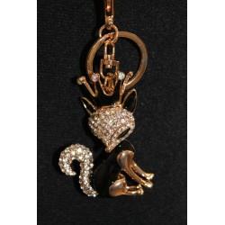 Porte clefs en métal argenté formant un renard noir tête couronnée.