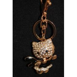 Porte clefs petit chat noir et doré fait de strass.