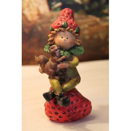 Lutin des bois sur une fraise